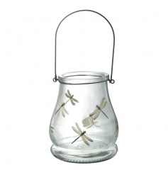 A pretty glass lantern with handle, decorated with a dragonfly design.