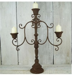 A stunning and ornate candelabra with a rust effect rustic finish.