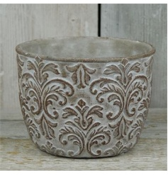 A rustic living aged stone effect planter with a beautiful damask design.