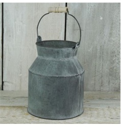 Vintage styled rustic churn with a worn down look