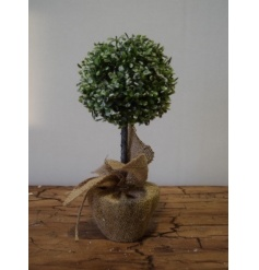 An authentic looking frosted topiary ball with hessian sack and pretty lights.