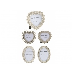 An assortment of 4 picture frames with pretty detail