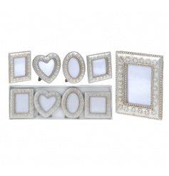 A set of 4 pretty photo frames with a vintage silver finish.
