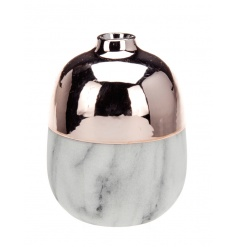 A stunning and on trend marble vase with copper top. A chic home accessory.