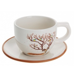 A unique cup and saucer with woodland reindeer design.