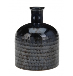 A striking oil blue vase with a textured tonal surface. A stunning home decoration.