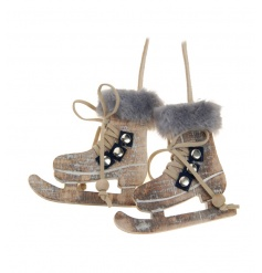 A pair of wooden hanging skates with a fur trim. Chic and stylish festive decorations.