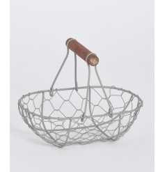 Shabby Chic basket suitable for holding an assortment of objects.