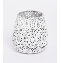 A shabby chic white metal candle holder with an attractive decorative pattern.