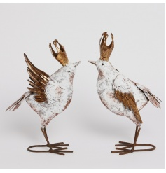 A mix of 2 decadent metal bird decorations with crowns. Unique decorative items with a distressed finish.