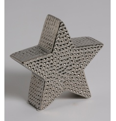 A stylish star shaped decorative ornament with a decorative hammered finish.