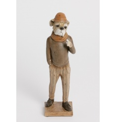A unique dressed bulldog figure with cap and scarf. A stylish home decoration.