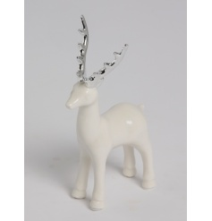 A contemporary style reindeer decoration with elegant silver antlers. A chic seasonal accessory for the home.