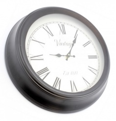 A charming black vintage clock which will compliment many interior styles and designs.