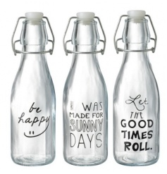 A mix of 3 glass bottles with stopper. Each is decorated with a different slogan. A great practical item for the home.