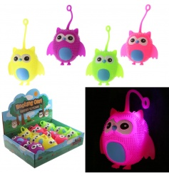 An assortment of 4 squidgy owl toys with LED lights.