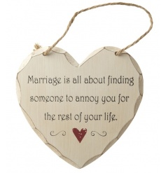 Humorous wooden hanging plaque about marriage