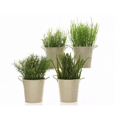 An assortment of 4 artificial herb planters set within cream zinc pots. A chic home accessory and stylish kitchen item