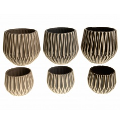 An assortment of 3 terracotta planters each with a graphic geometric design. The assortment includes 3 natural colours.