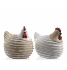 An assortment of 2 ceramic chicken ornaments in cream and white designs. A lovely addition to any home this season.