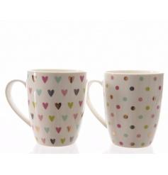 An assortment of 2 pretty multi-coloured heart and polka dot design mugs.
