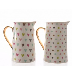 An assortment of 2 pretty multi-coloured heart and polka dot design jugs, each with a gold handle.