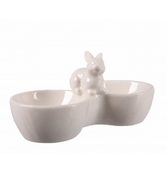 An adorable egg cup holder with bunny. Perfect for two dippy eggs or two chocolate eggs!