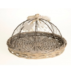 A pretty wicker tray with wire lid decorated with ribbon and wooden butterflies. Ideal for keeping pesky flies away.