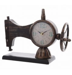 A unique clock set within an antique style sewing machine ornament.