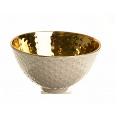 A glamorous cream and gold highly finished decorative bowl with a hammered centre and decorative edge.