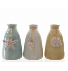 An assortment of 3 coastal inspired glazed vases, each with a hanging shell ornament.