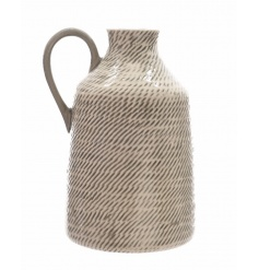 A stylish pitcher with a patterned finish. A country style item with a handmade appearance.