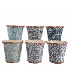 An assortment of 6 hand decorated terracotta planters in blue patterned designs.