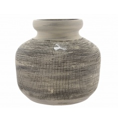 A stylish handmade decorative vase with a textured surface pattern and a grey wash finish.