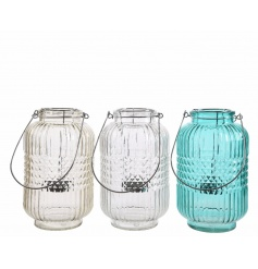 An assortment of 3 glass hurricane lanterns in clear, amber and light blue colours.