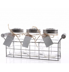 A set of 3 mason jar style bottles set within a grey wire tray. Each jar comes with a metal label.