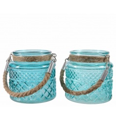 An assortment of 2 turquoise and aqua hurricane lanterns with coastal inspired chunky rope handles.