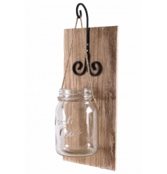 A charming mason jar flower pot hung from an iron hanger and wooden panel. Perfect for displaying outside your home