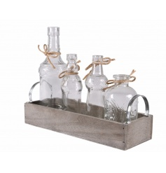 A pretty set of vintage style bottles, each with jute bows set within a wooden tray with handles.