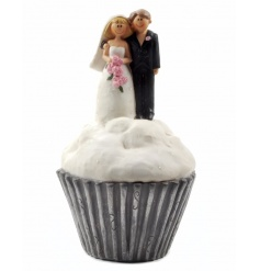 A beautiful and unique bride and groom ornament set upon a cupcake. A lovely gift item.