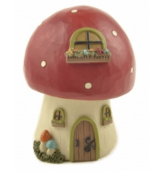 A magical mushroom house decoration. A wonderful decoration for all to enjoy and for the imaginative to explore.