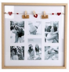 A stylish multi-frame with space for six images. Complete with a peg garland with hearts and best friend text.