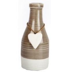 A stylish bottle shaped vase with a glazed finish and a hanging heart decoration.