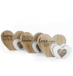 An assortment of 3 heart shaped plaques with a decorative wooden pattern. Each is decorated with a home sentiment slogan