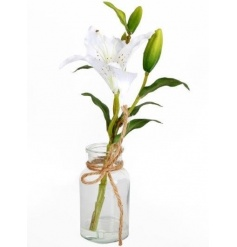 A stylish artificial flower arrangement set within a glass bottle with hessian bow.
