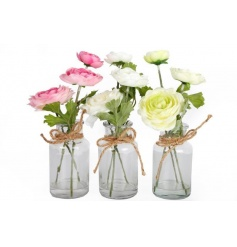 A mix of renunculus flowers set within glass jars with jute string.