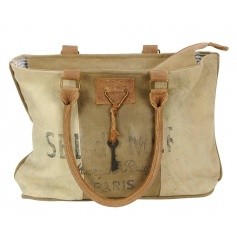 A vintage design bag made from up-cycled materials. Complete with a decorative key.