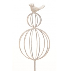 A shabby chic style decorative stake with twin spheres and a bird ornament.