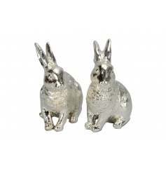 An assortment of 2 antique style rabbit ornaments, making a charming decorative accessory for the home.