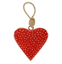 A red and white polkadot metal heart with a chunky jute rope hanger.